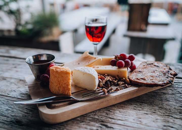 Delicious-cheese-plate-various-cheeses-with-red-port-at-a-beach-club