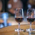 Two-Port-Wine-glasses-against-a-Port-Winery-background-in-Portugal