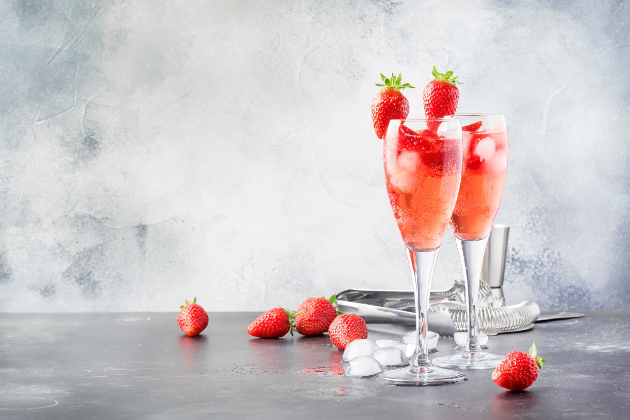 Rossini-alcoholic-cocktail-with-Italian-sparkling-wine-strawberry-puree-and-ice-in-champagne-glasses-place-for-text-selective-focus