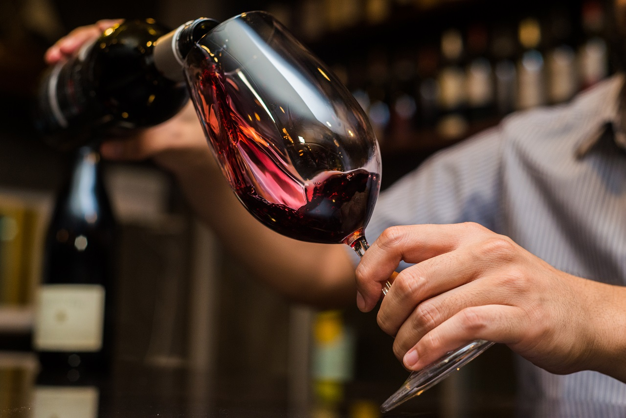 Waiter-pouring-red-wine-in-a-glass